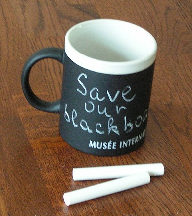 A coffee mug with chalk writable surface